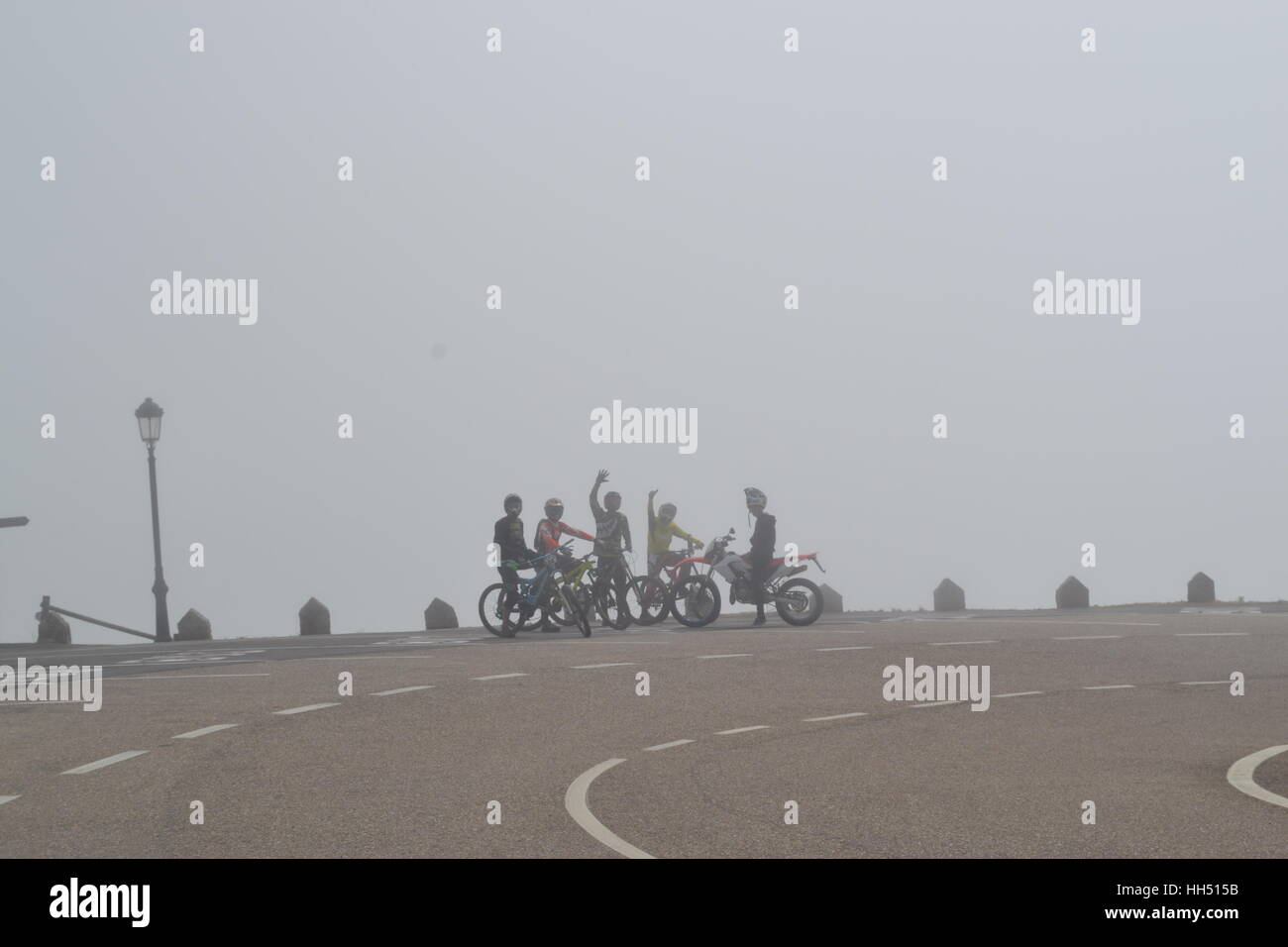 cyclist  on hilltop - Stock Image