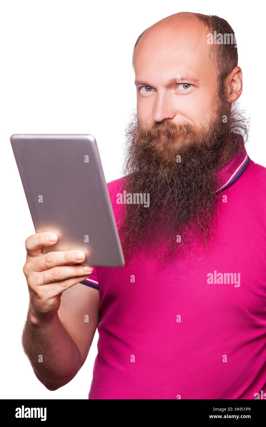 portrait of bald bearded man with tablet and pink t-shirt isolated on white background. Stock Photo