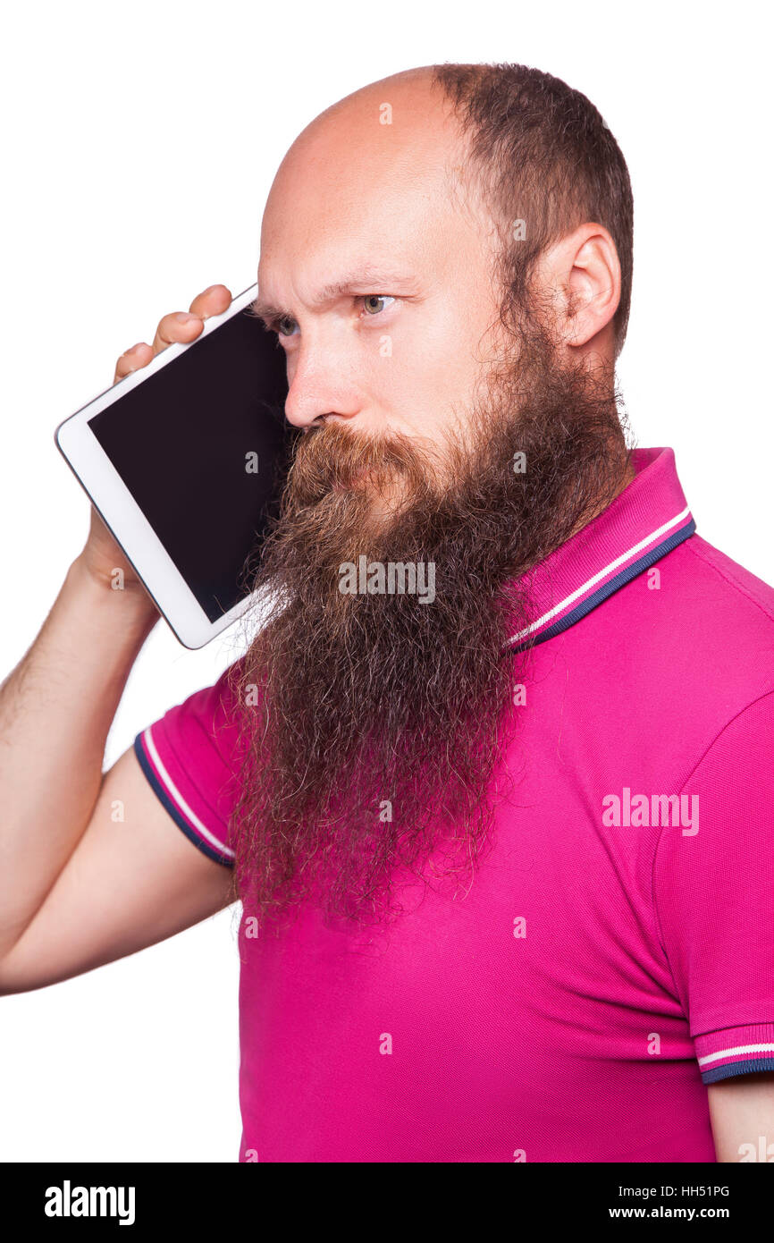 portrait of bald bearded man with tablet and pink t-shirt isolated on white background. - Stock Image