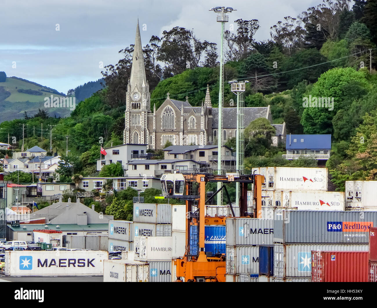 Church in backdrop of Port Chalmers, Dunedin, New Zealand - Stock Image