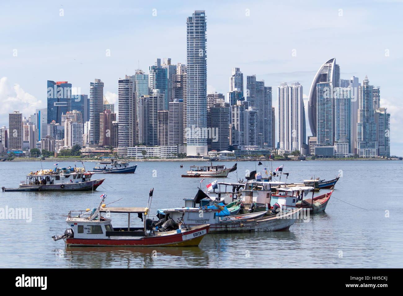 June 15, 2016 Panama City, Panama: small fishing boats floating on the water with the modern downtown high-rises - Stock Image