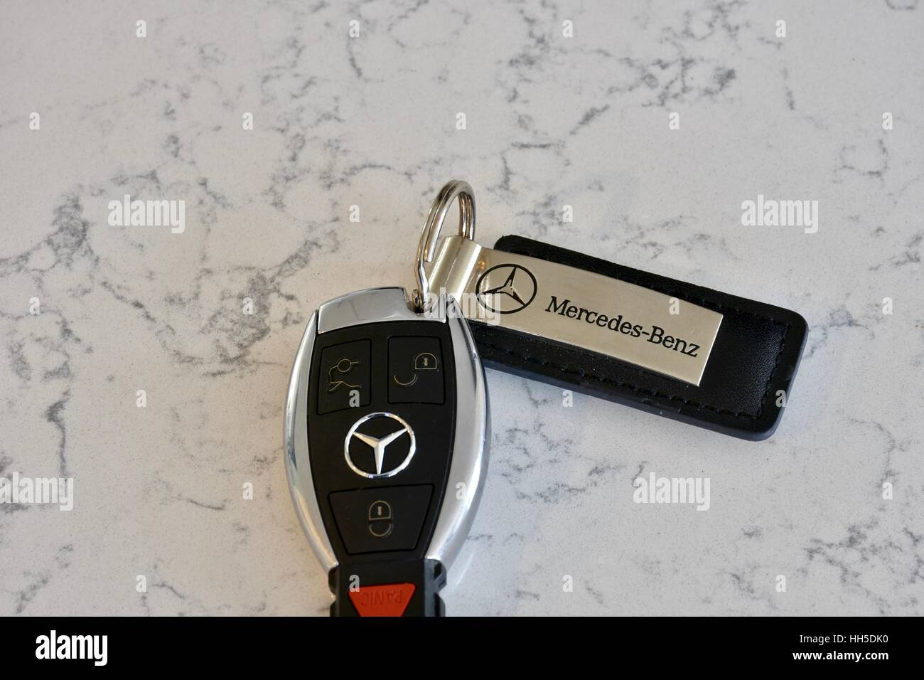 Mercedes Benz key fob on a white marble surface Stock Photo