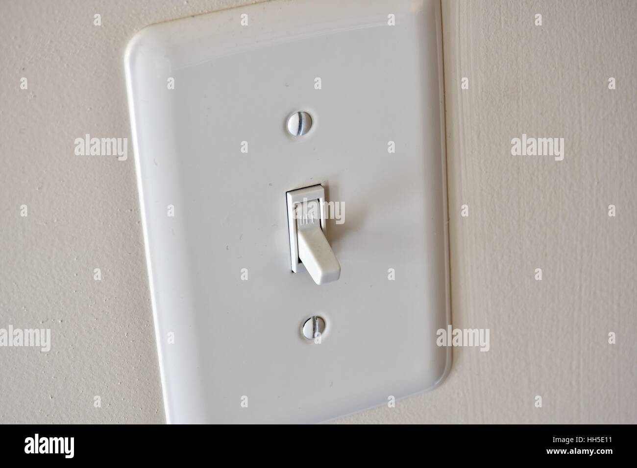 A light switch in a residential home - Stock Image
