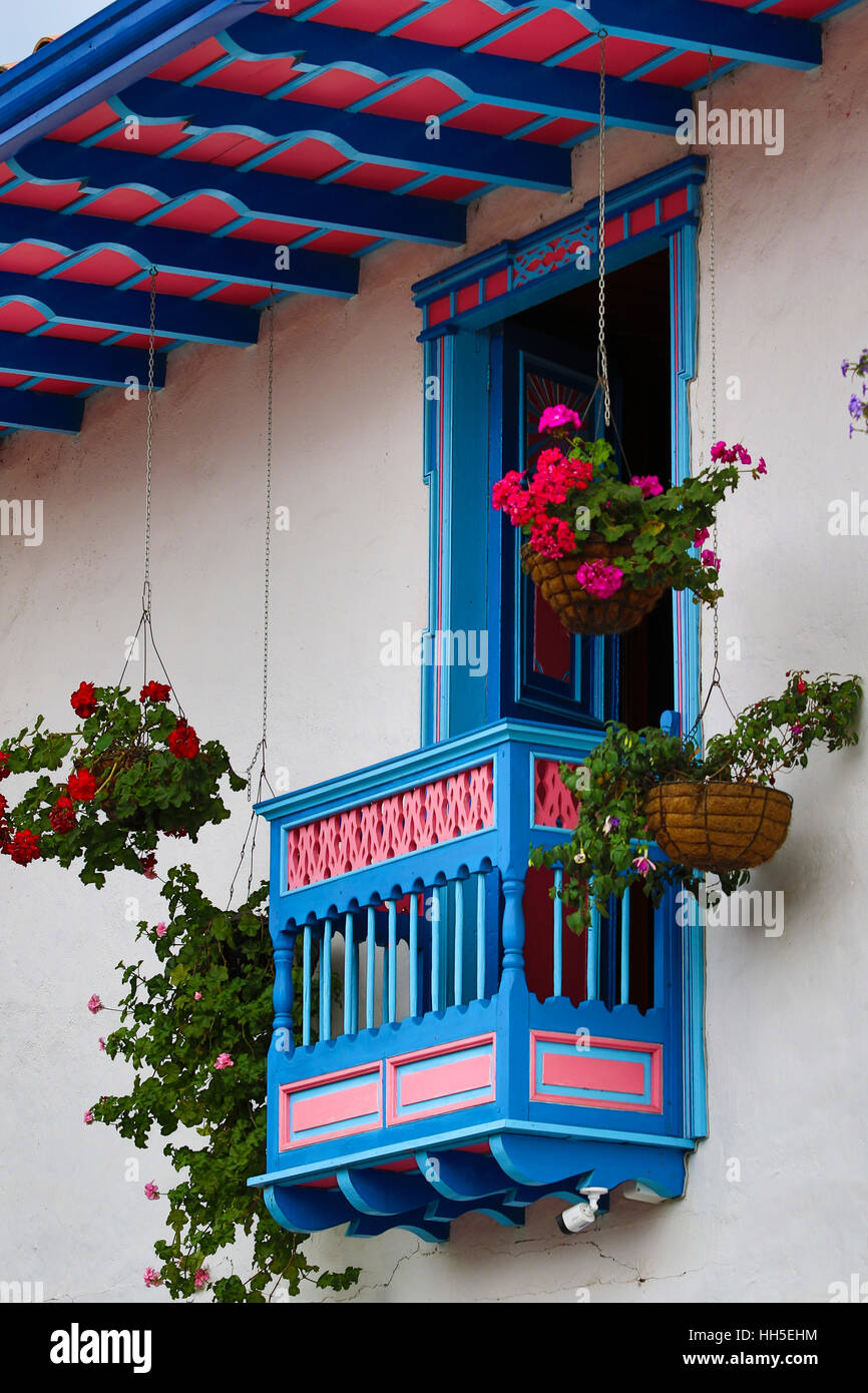 Colorful balcony closeup with hanging baskets of flowers - Stock Image