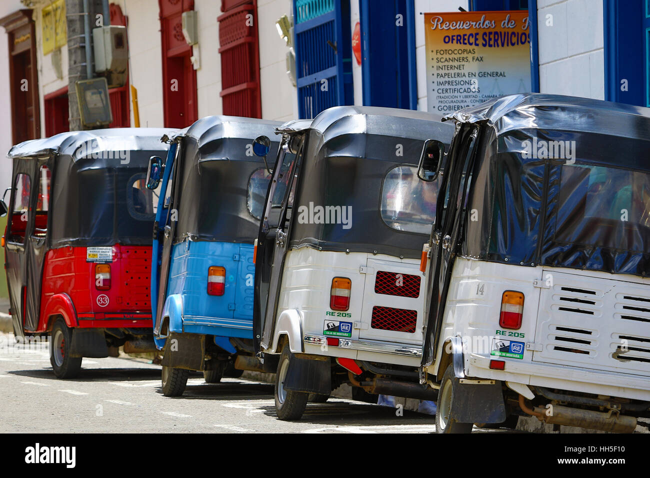 September 30, 2016 El Jardin, Colombia: small three wheeled motorized taxis called moto-raton waiting for customers - Stock Image