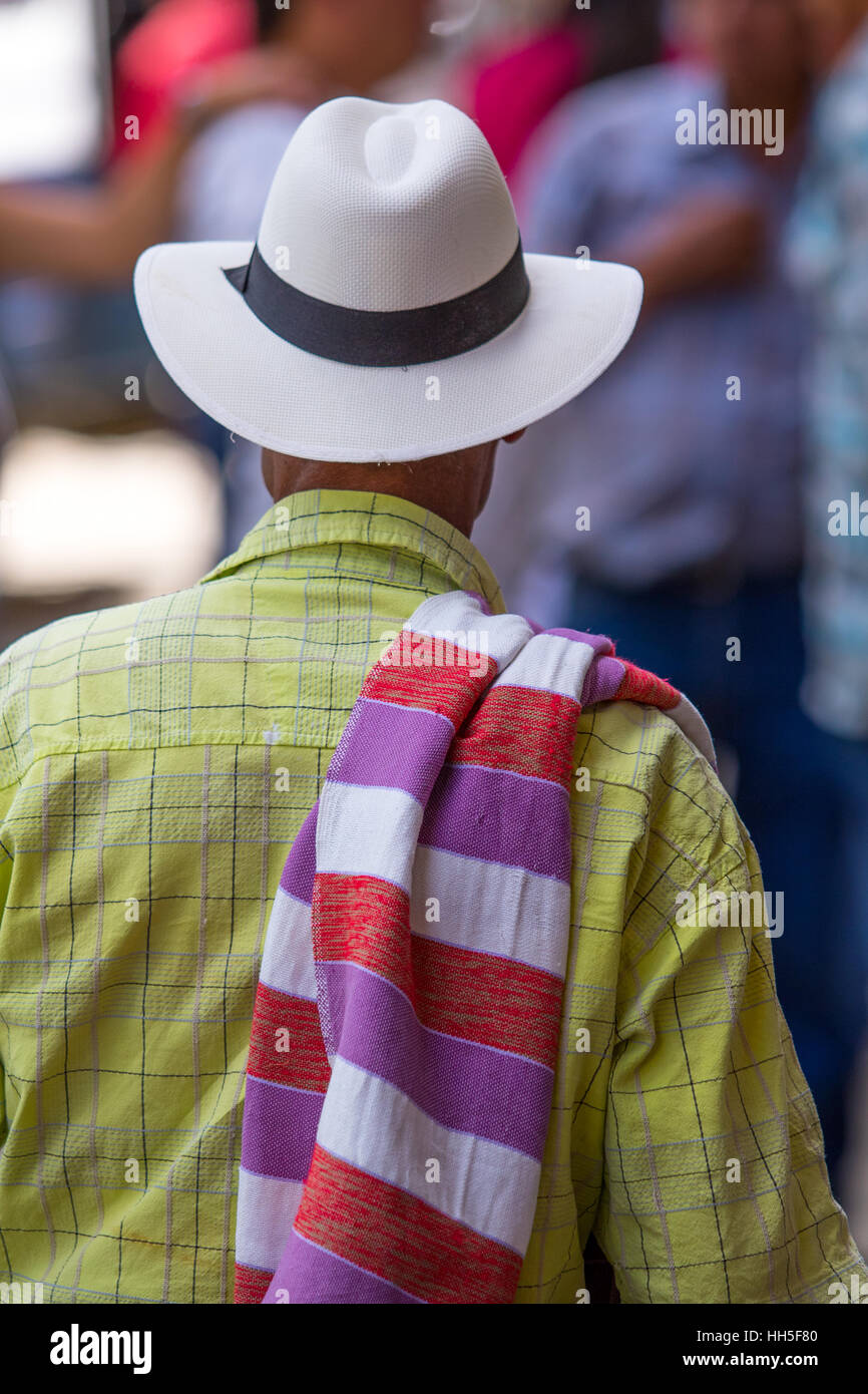 man wearing a traditional colombian straw hat and colorful poncho - Stock Image