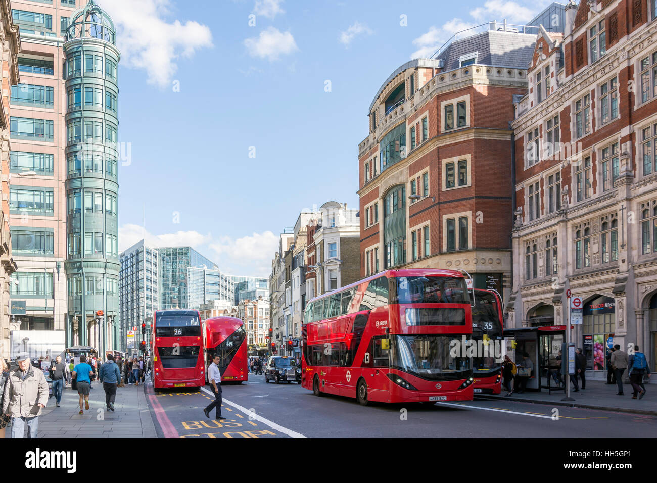 Double-decker buses in Bishopsgate, City of London, Greater London, England, United Kingdom - Stock Image