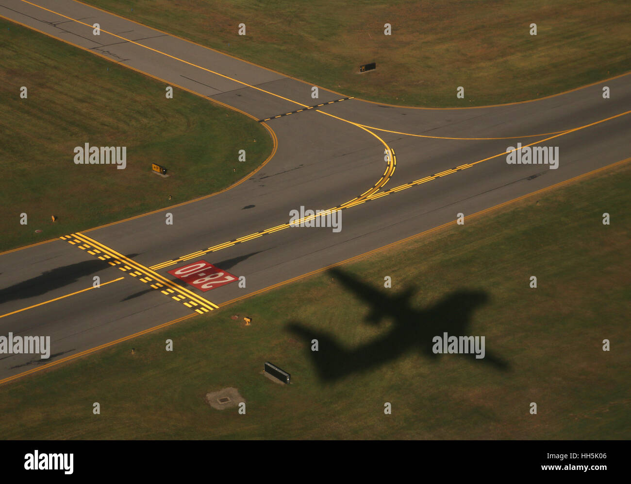 Airplane shadow takeoff on runway airport New York - Stock Image