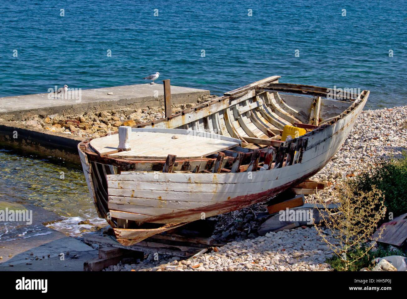 Old wooden boat broken by the sea, Dalmatian coast, Croatia Stock Photo
