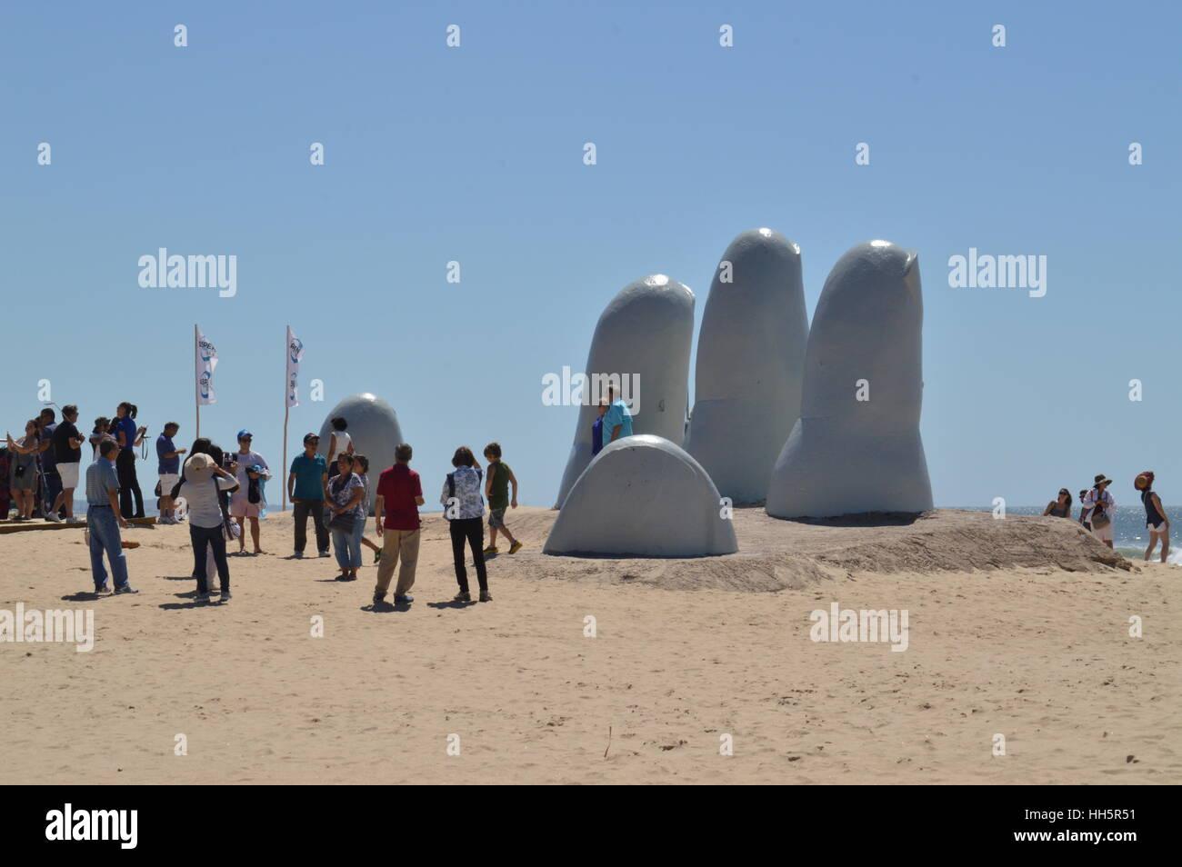 The Hand sculpture of Punta del Este, or Mano de Punta del Este at Parada 4 on the sands of  Brava beach, by Mario - Stock Image