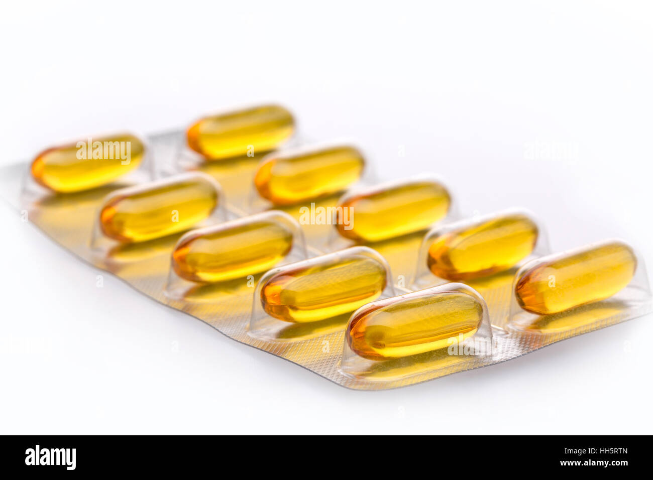 Cod Liver Oil capsules against a white background - Stock Image