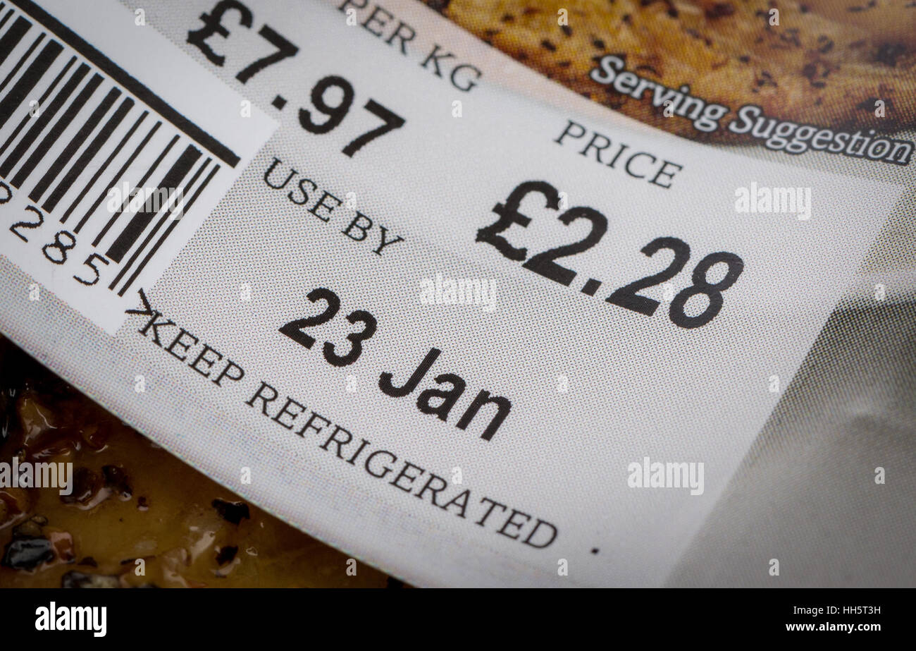 Use by Date label on a packet of fish - Stock Image