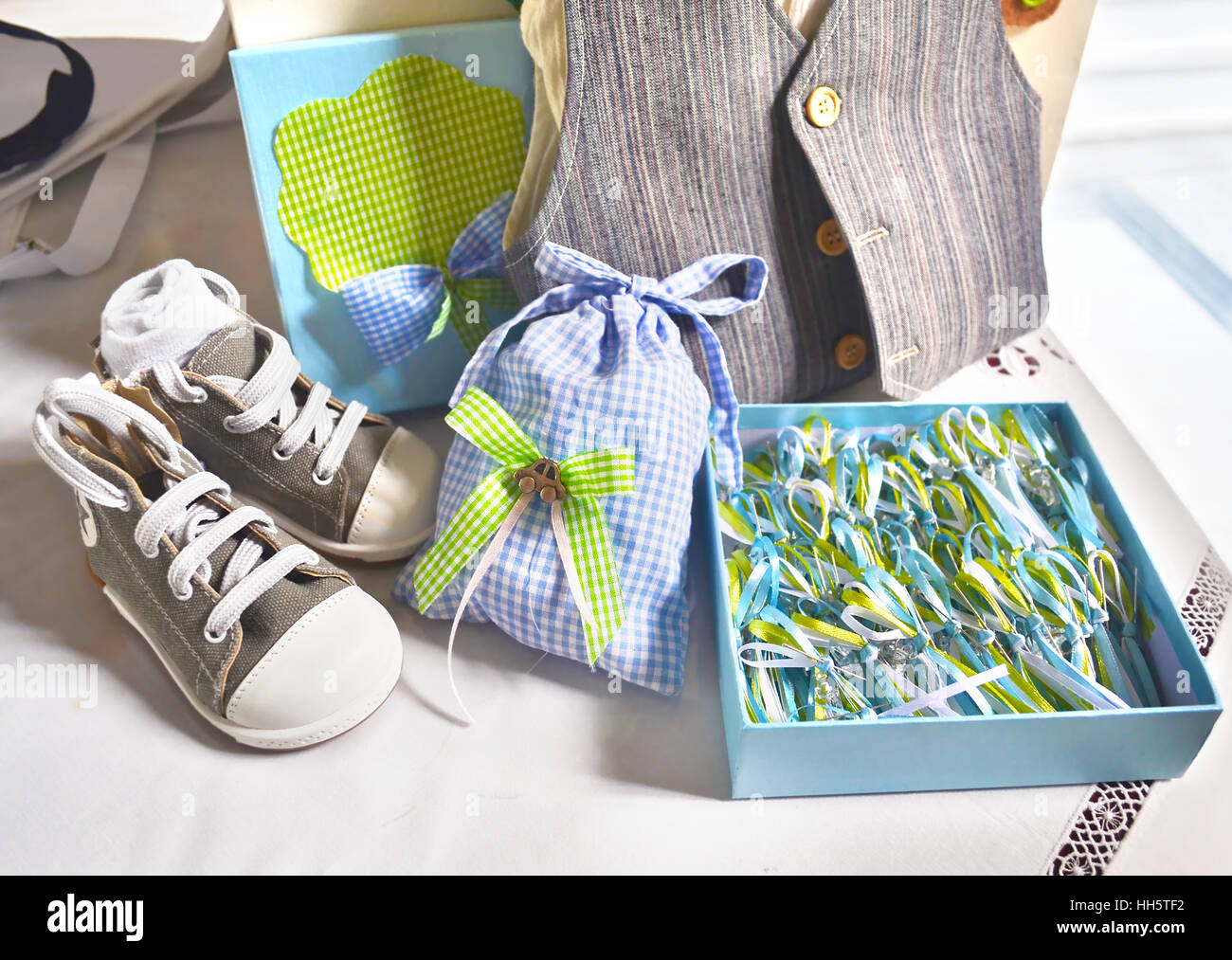 greek Orthodox christening clothes and favors - Stock Image