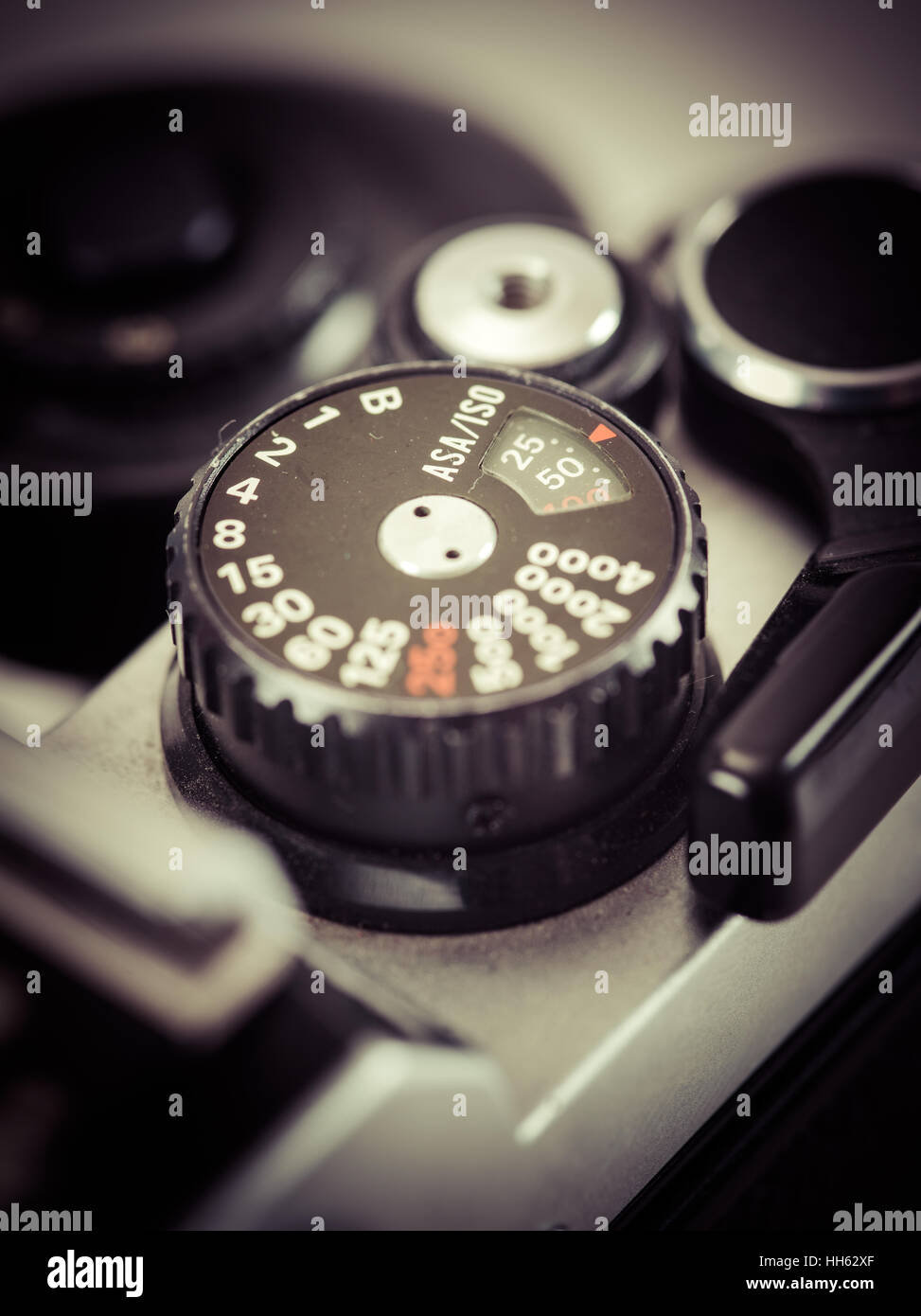 Macro photo of the shutter knob of an old 35mm film camera. Filtered to look vintage. - Stock Image