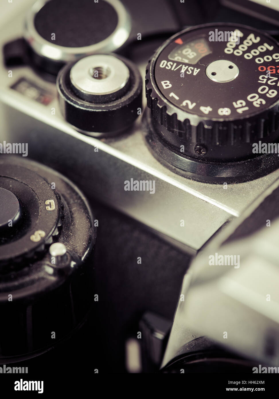 Macro photo of the shutter knob and shutter release of an old 35mm film camera. Filtered to look vintage. - Stock Image