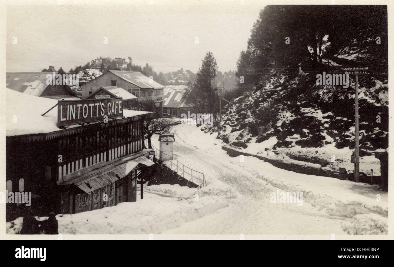 Mall Road, Murree Hill Station, with Lintott's Cafe on the left, with snow on the ground, Punjab Province, British - Stock Image