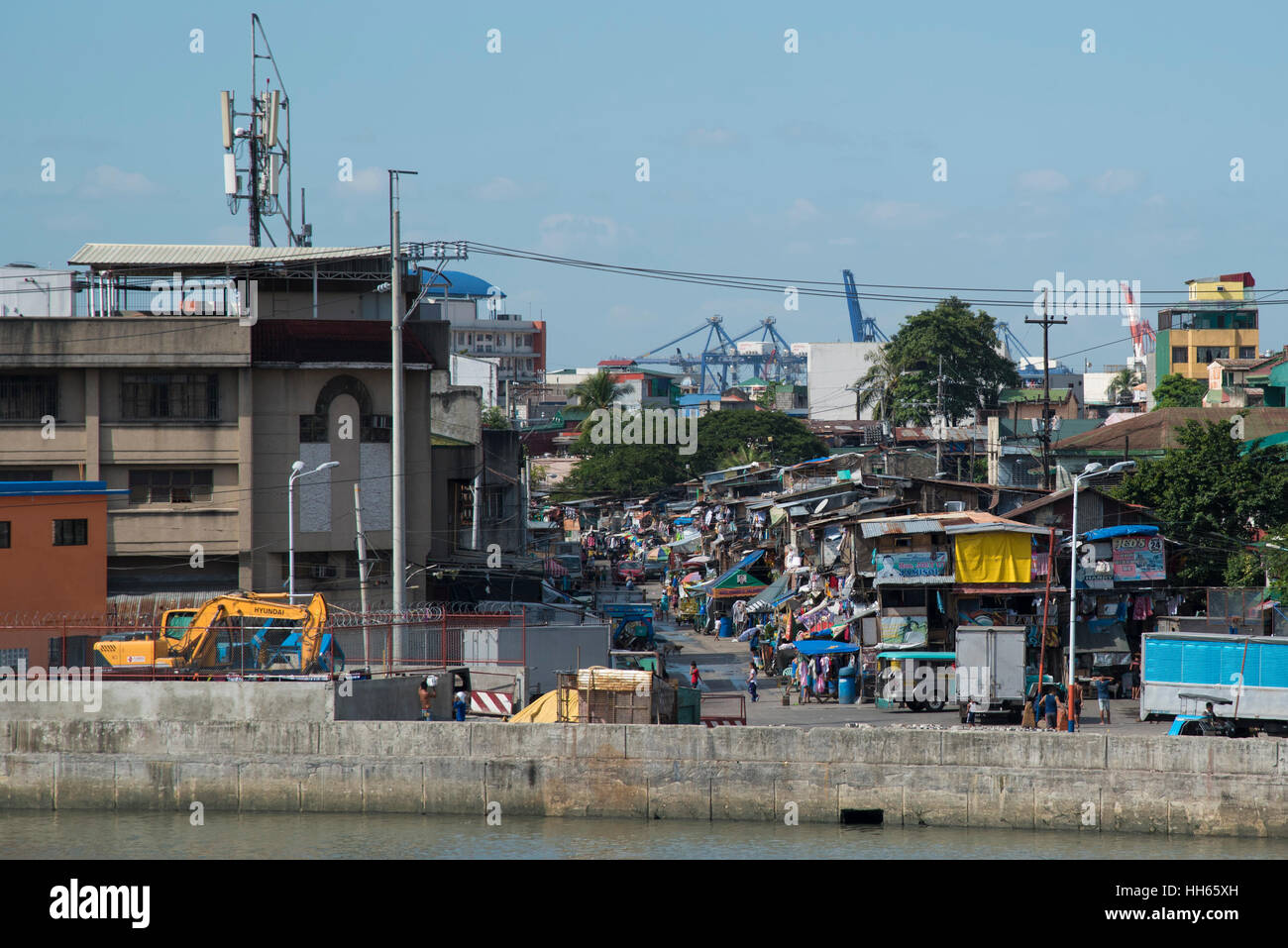 Crowded neighborhood next to Pasig River and Fort Santiago, in Manila, Philippines - Stock Image