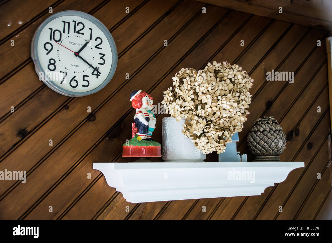 Mantle decoration and wall clock - Stock Image