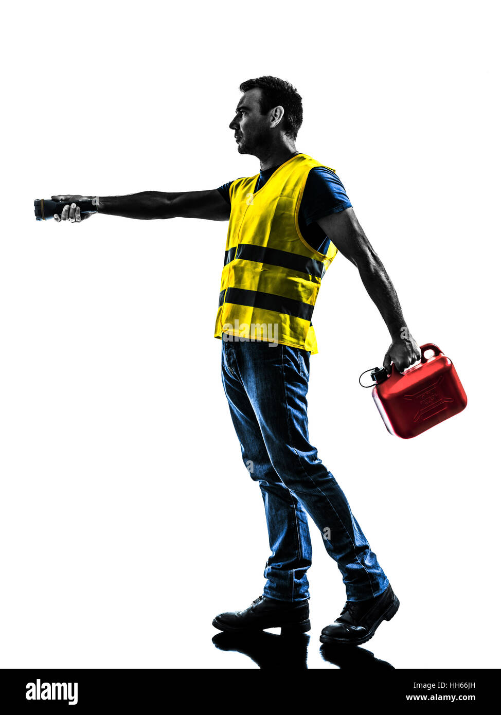 one man out of gas walking with safety vest and gasoline can silhouette isolated in white background - Stock Image