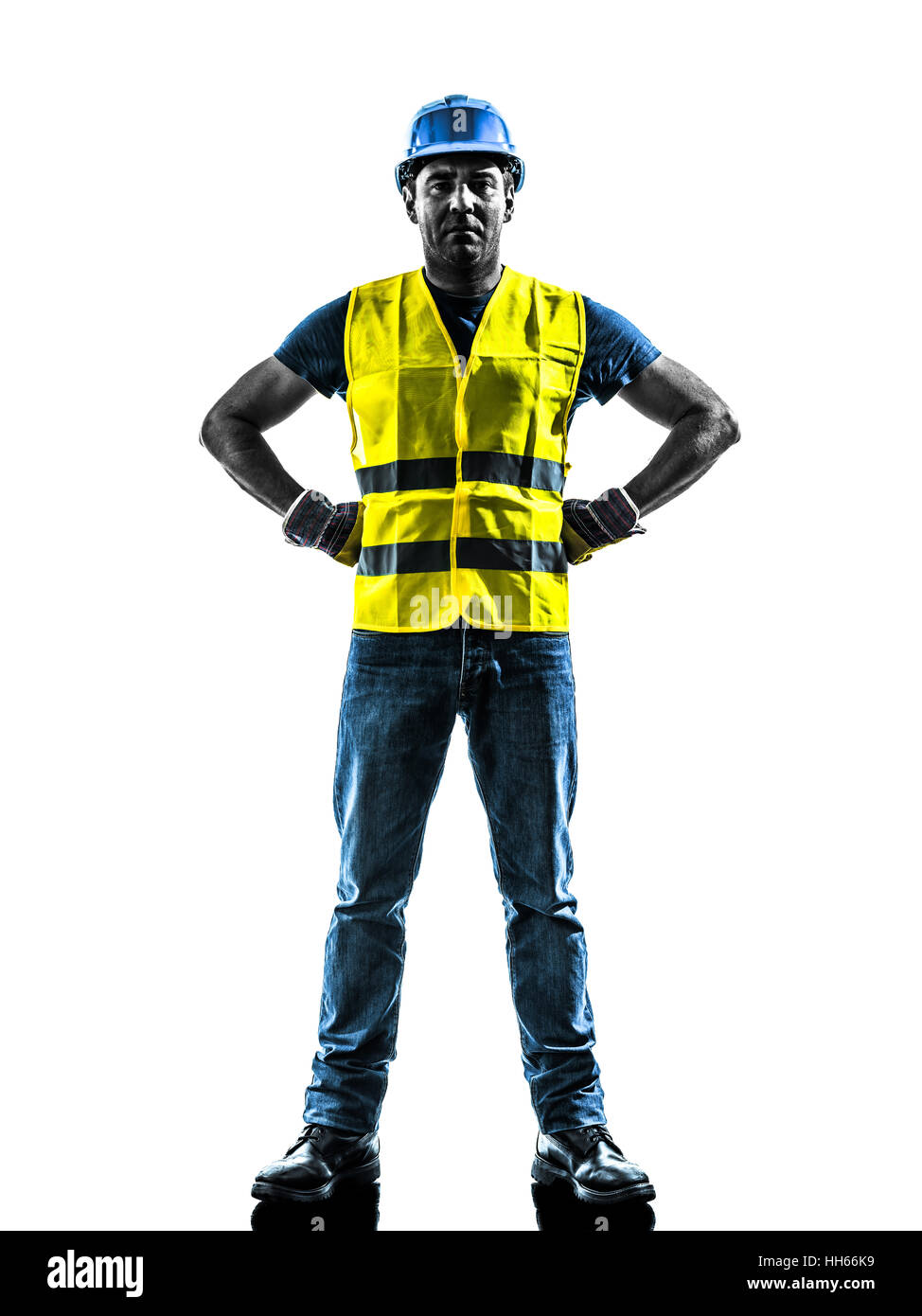 one construction worker standing with safety vest silhouette isolated in white background - Stock Image