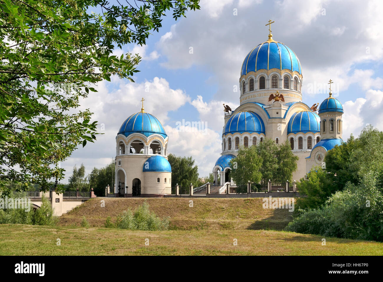 Holy Vivifying Trinity Cathedral Framed by Trees in Summer at Kashirskoye highway. Moscow, Russia - Stock Image