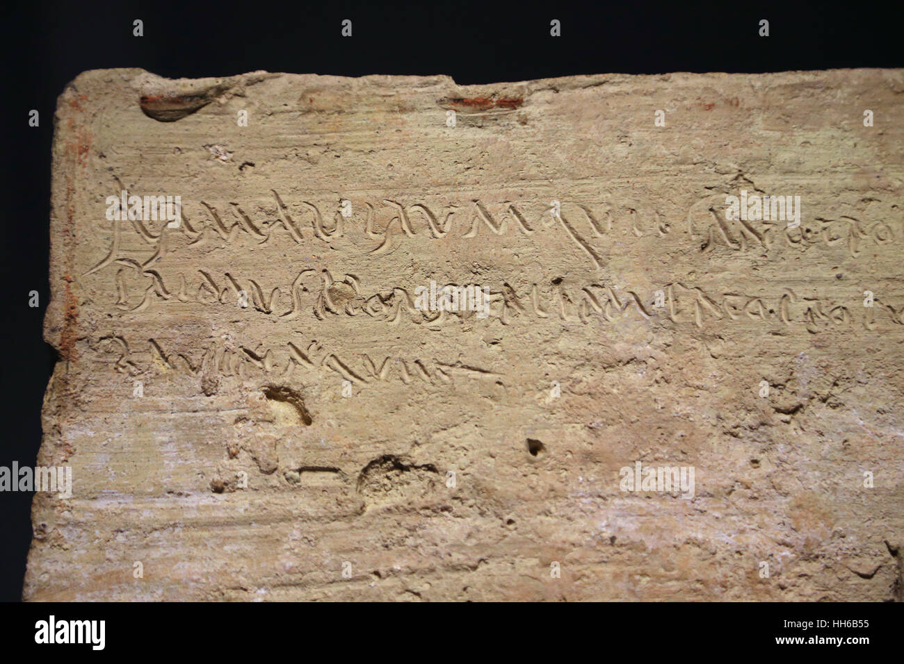 Epigraphic plaque. Latin language. Clay. 1st century. Cursiva inscription contains the opening lines of the Aeneid - Stock Image
