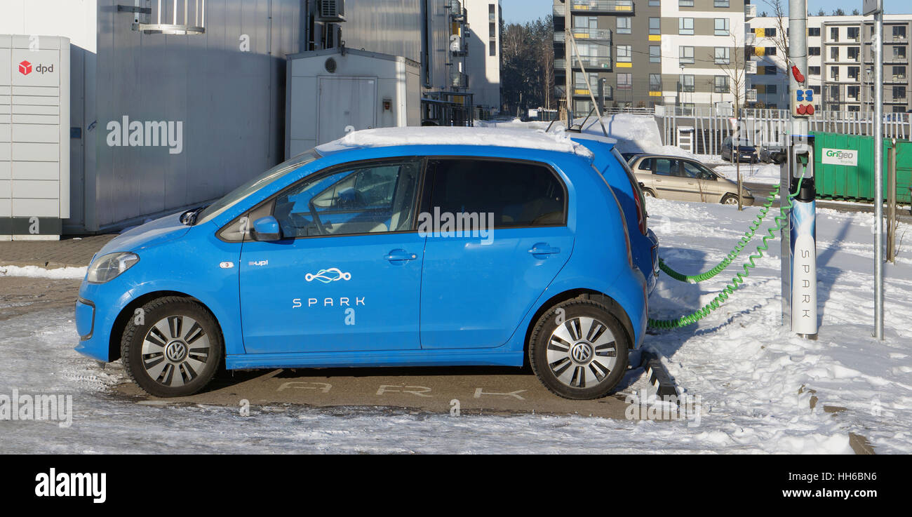 VILNIUS, LITHUANIA   JANUARY O7, 2017: Specialt Places For Rent And  Charging Of Electric Cars Volkswagen Golf Near The Winter Supermarket  Maxima. S