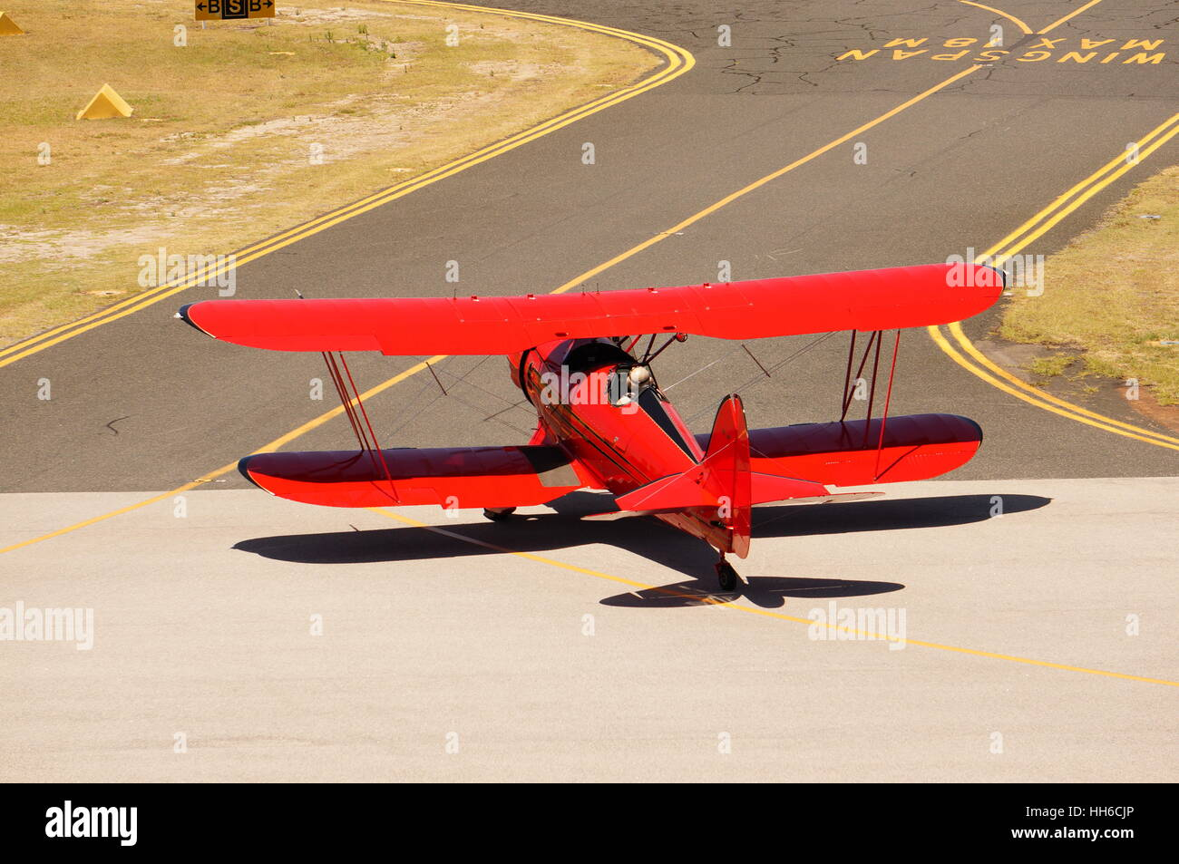 red biplane taxiing - Stock Image