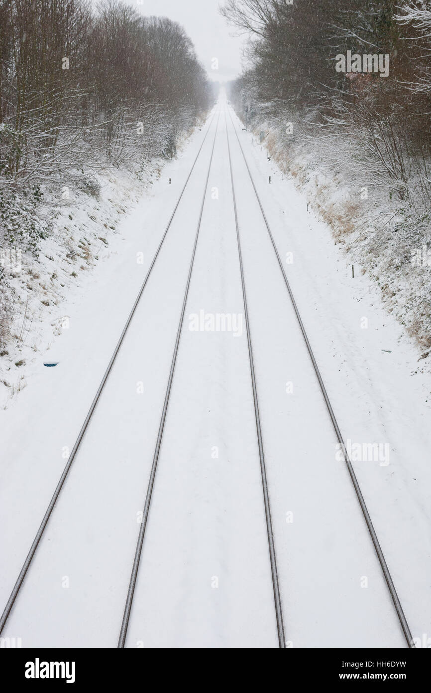 Dorking, Surrey, UK. Straight traintracks after fresh snow. - Stock Image