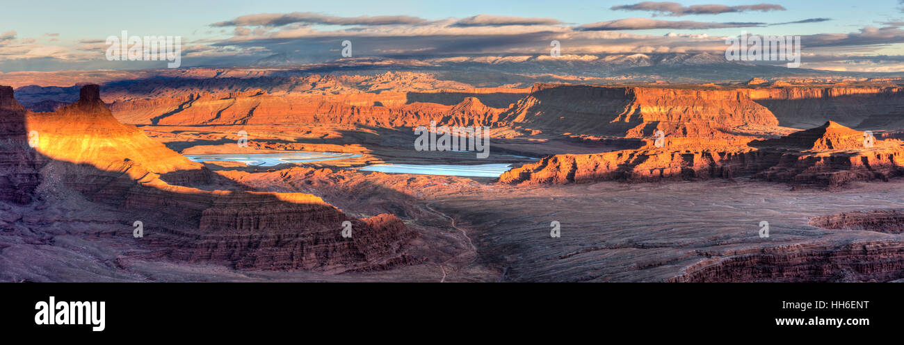 Potash evaporation ponds and the Behind the Rocks formations see from Dead Horse Point at sunset point near Moab, - Stock Image