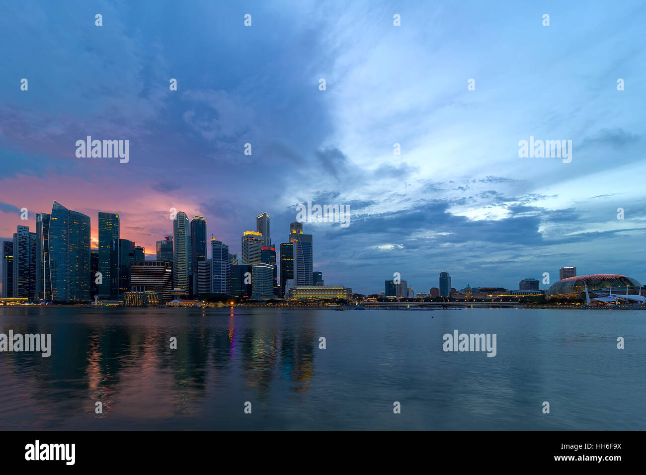 Sunset over Singapore Central Business District City Skyline by Marina Bay - Stock Image