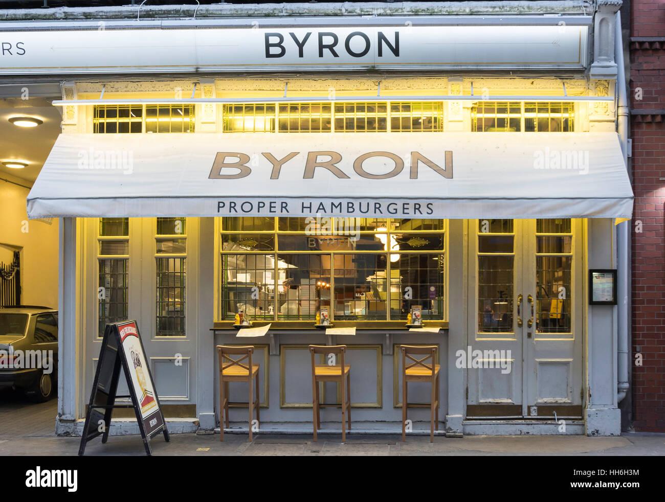 Byron Proper Hamburger Restaurant at dusk, Rathbone Place, Soho, City of Westminster, London, England, United Kingdom - Stock Image