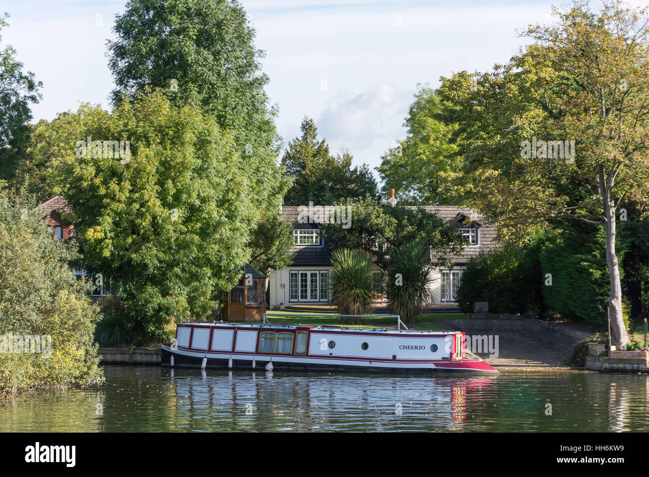 Riverside house and canal boat by River Thames, Runnymede, Surrey, England, United Kingdom Stock Photo