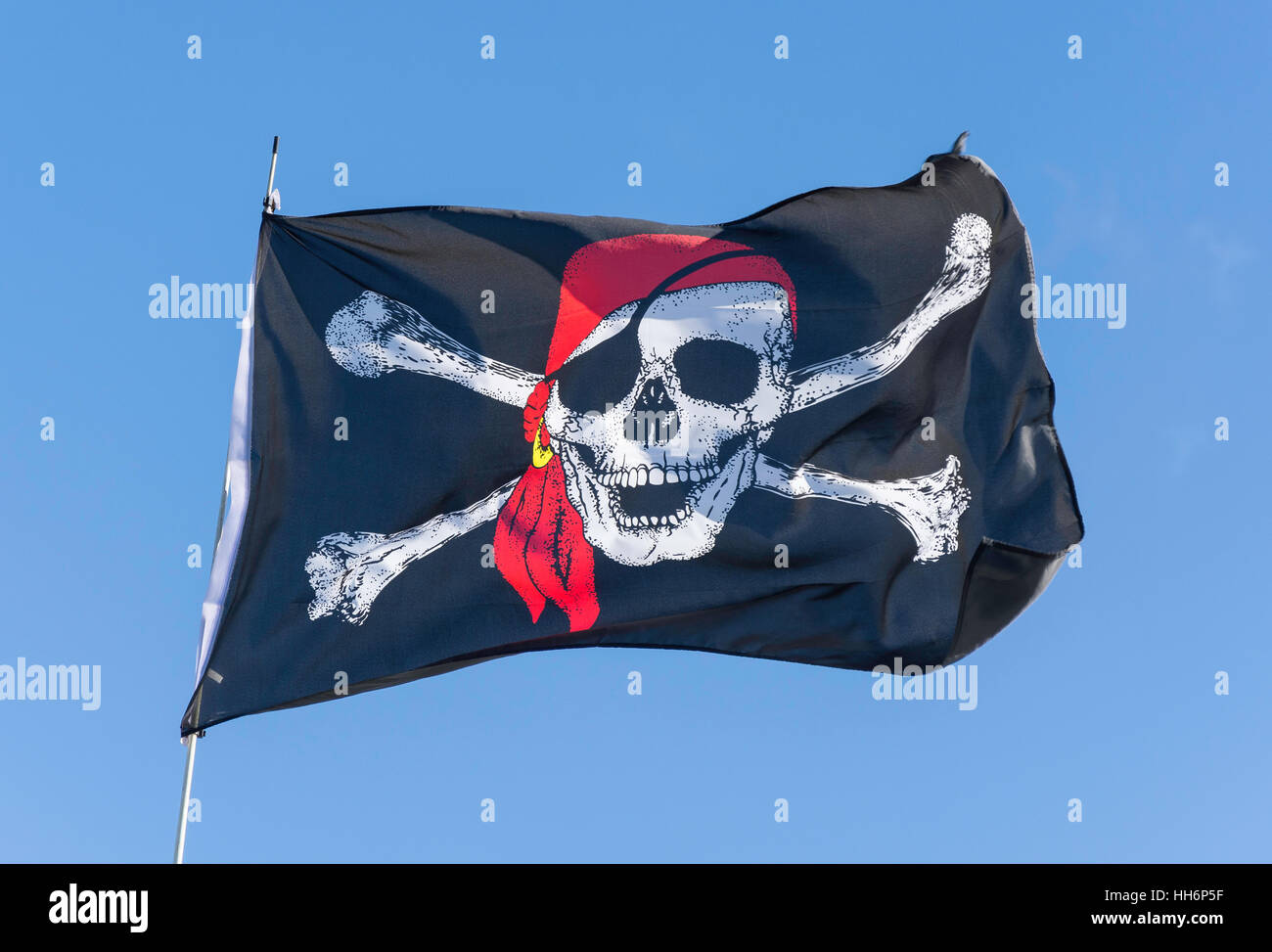 Pirate flag on boat by River Thames towpath, Old Windsor, Berkshire, England, United Kingdom - Stock Image