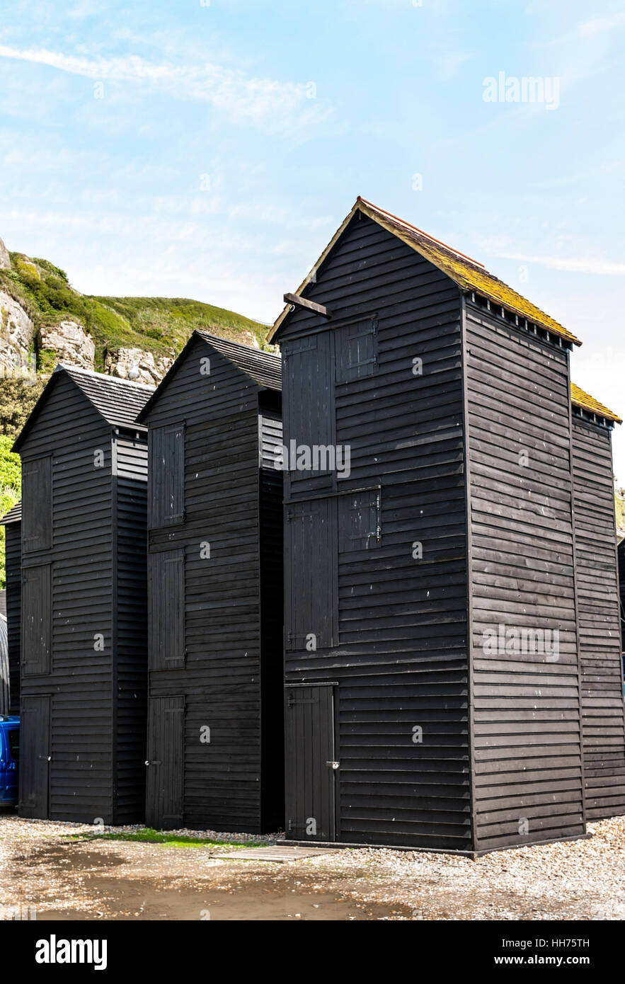 Historical Net-Shops in Hastings. These wooden constructions, weather boarded and tarred and used for storage - Stock Image