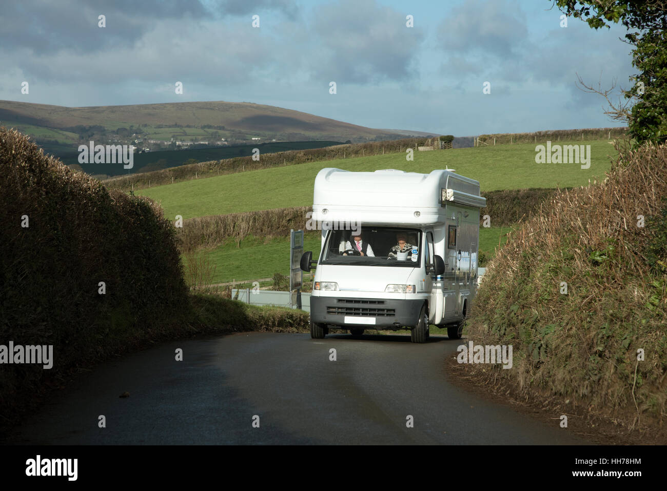 Motorhome on a narrow Devonshire lane in the South Hams district. England UK. January 2017 - Stock Image