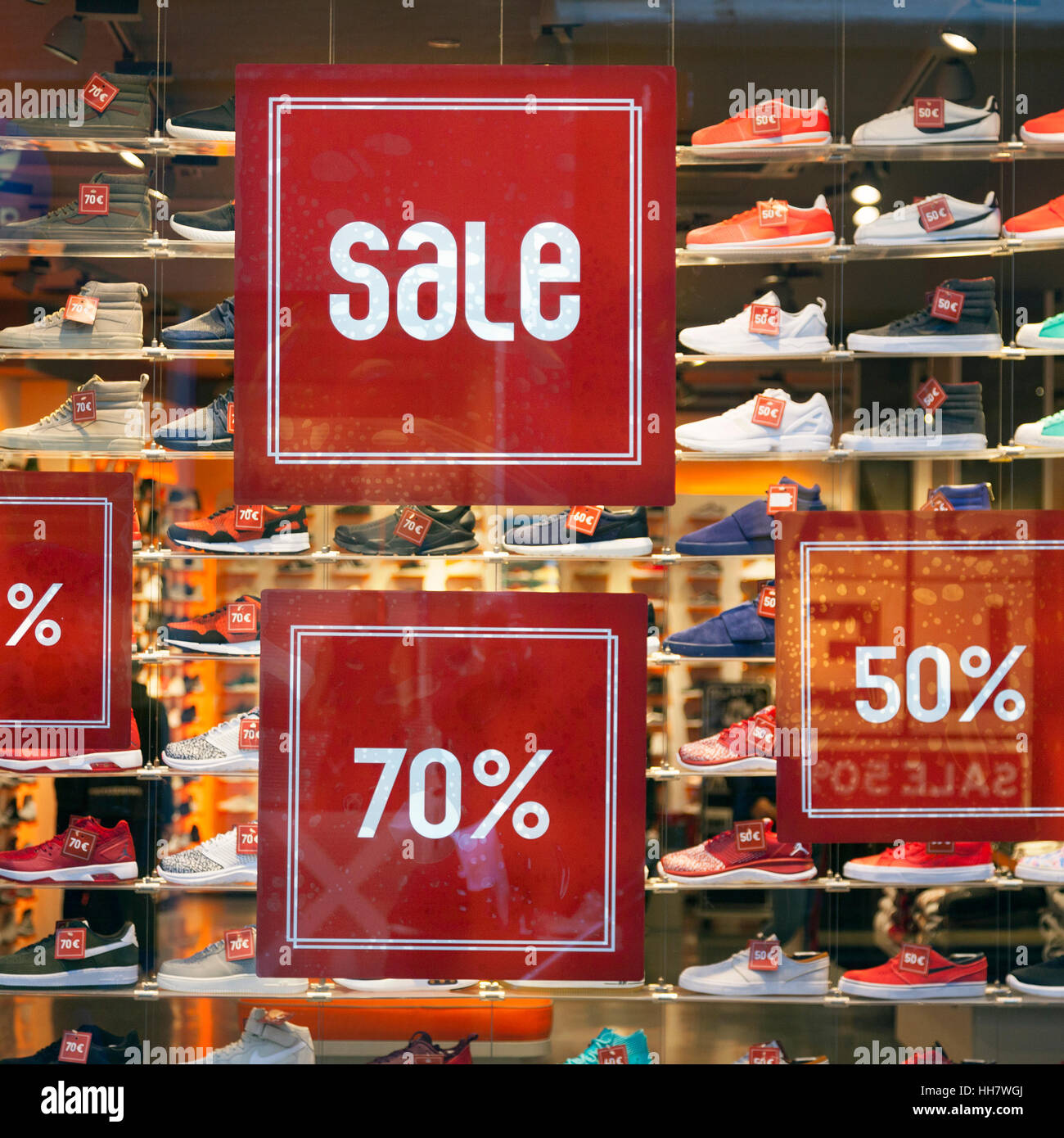 sale sign and discount numbers on shop window of shoe store Stock ... e325a686d