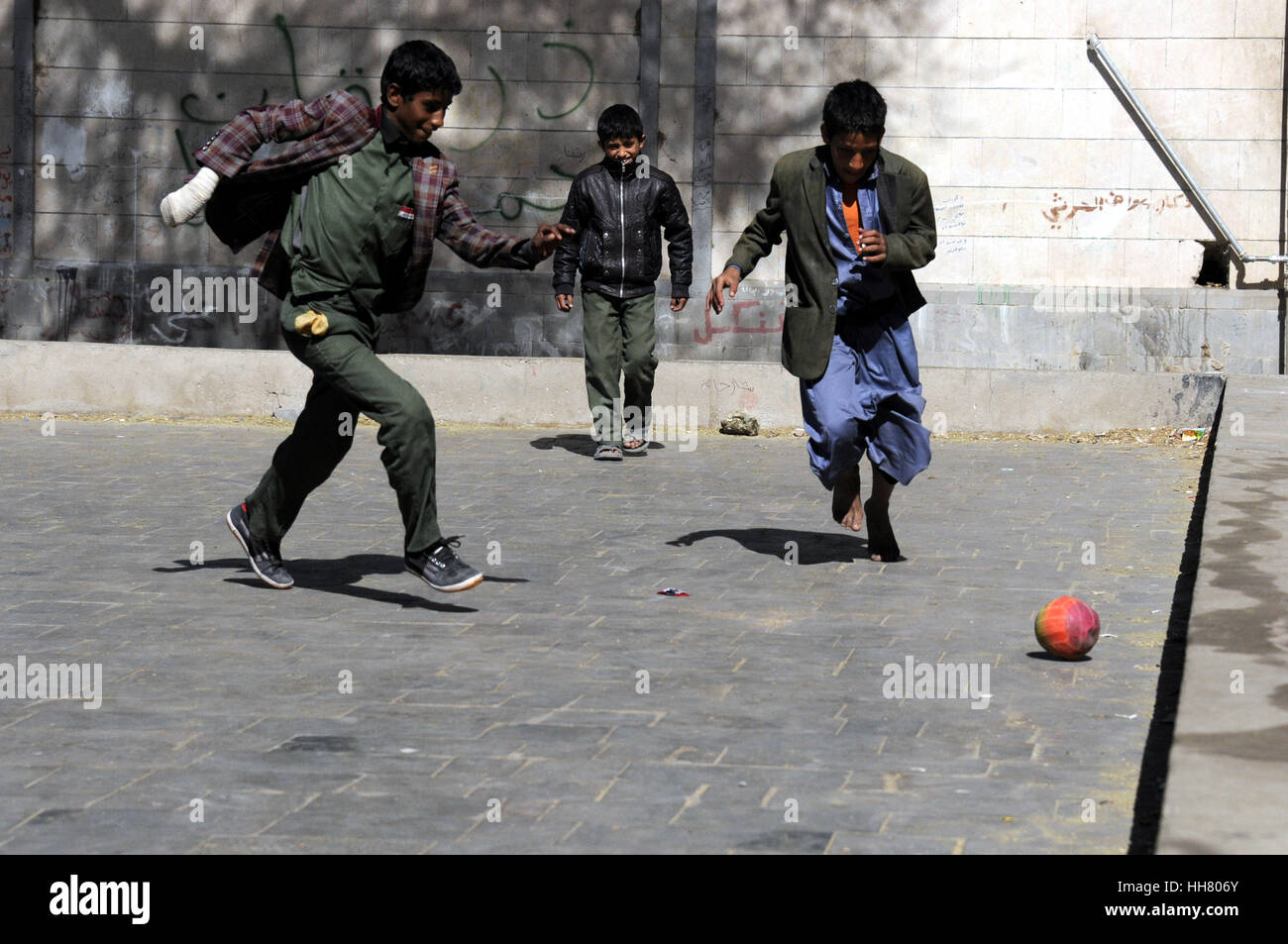 Sanaa, Yemen. 17th Jan, 2017. Orphans play football during their free time at the government-run Orphans Institution - Stock Image