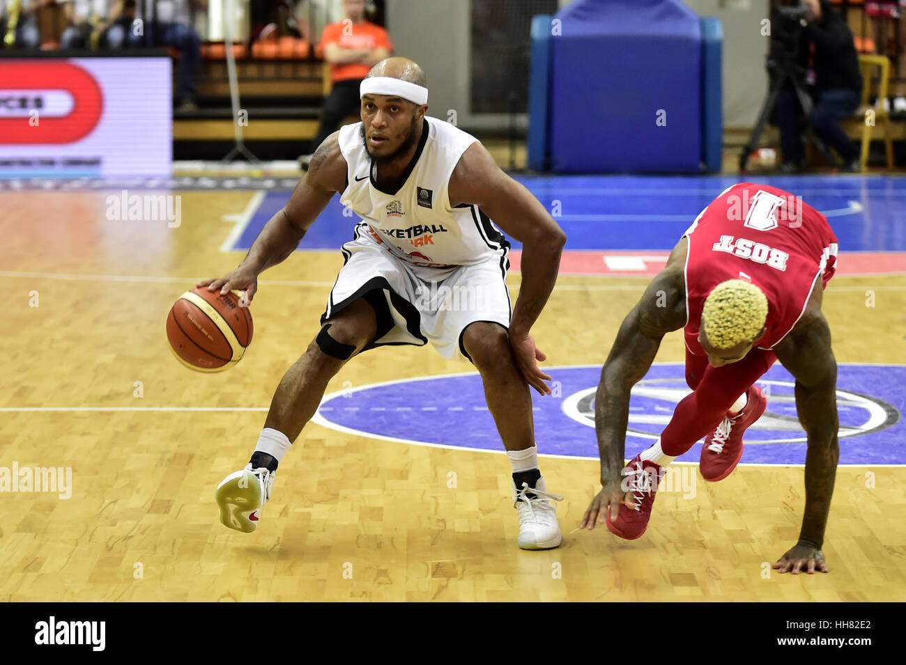 Nymburk, Czech Republic. 17th Jan, 2017. From left EUGENE LAWRENCE of Nymburk and DEE BOST of Monaco in action during - Stock Image