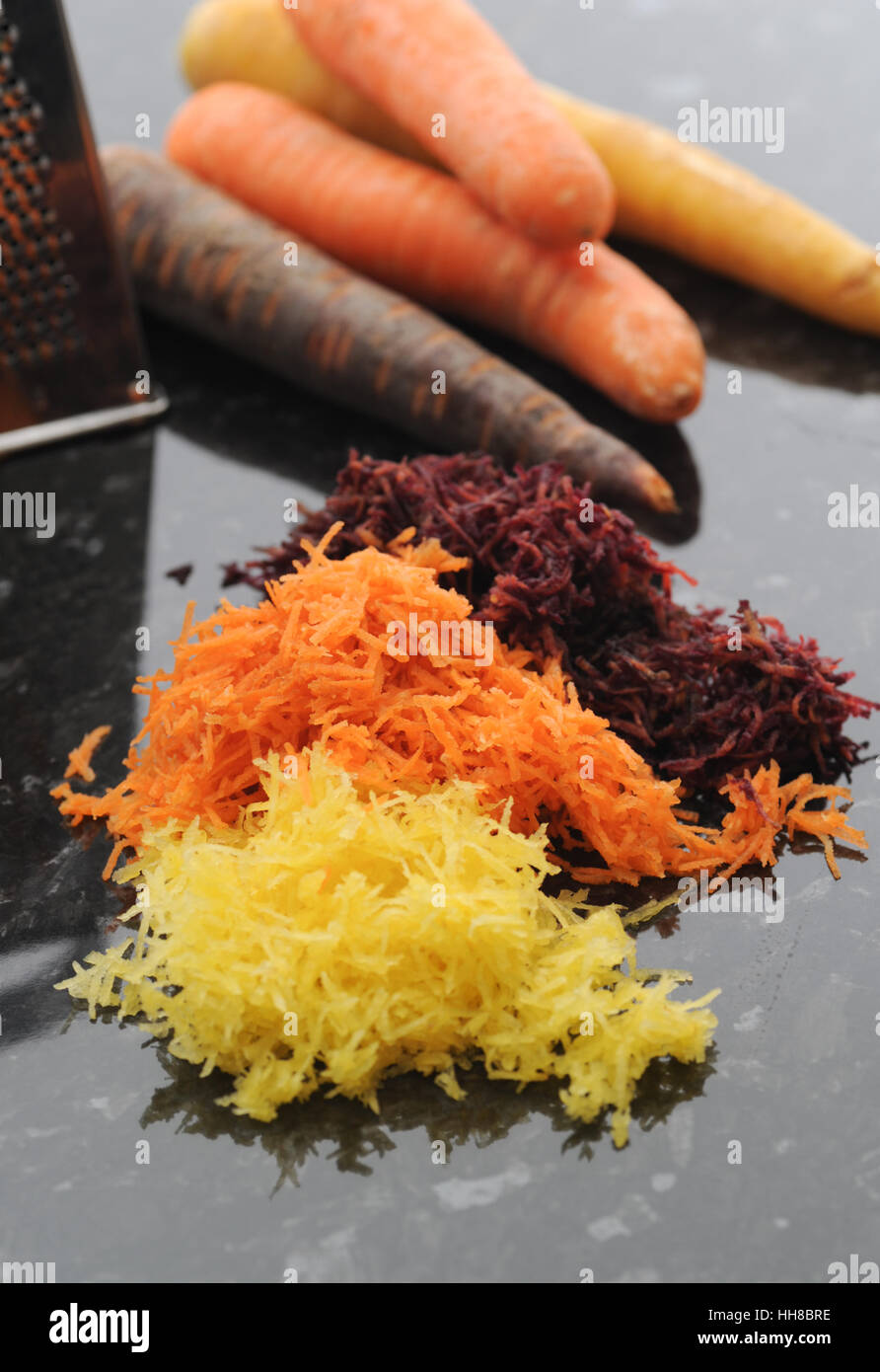 Grated carrot. Yellow, orange and purple. Stock Photo