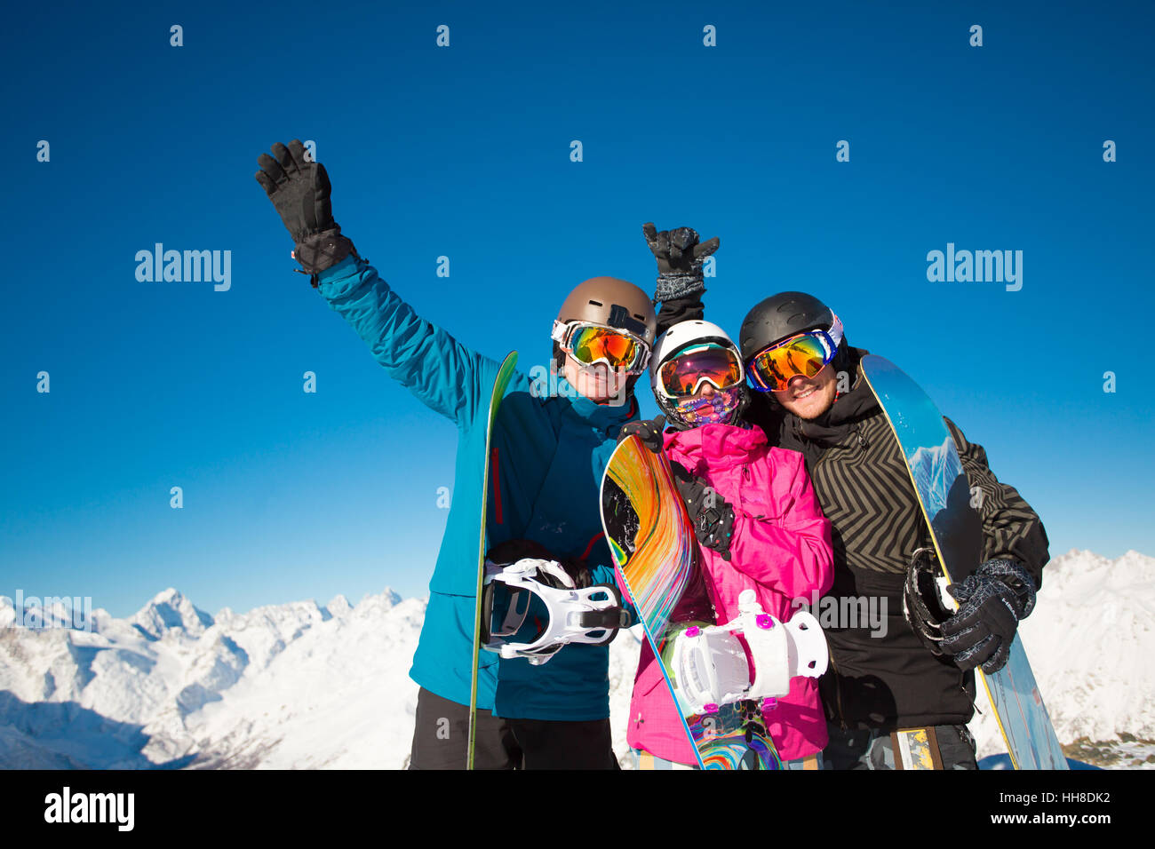 Group friends snowboarders have fun on the slope - Stock Image