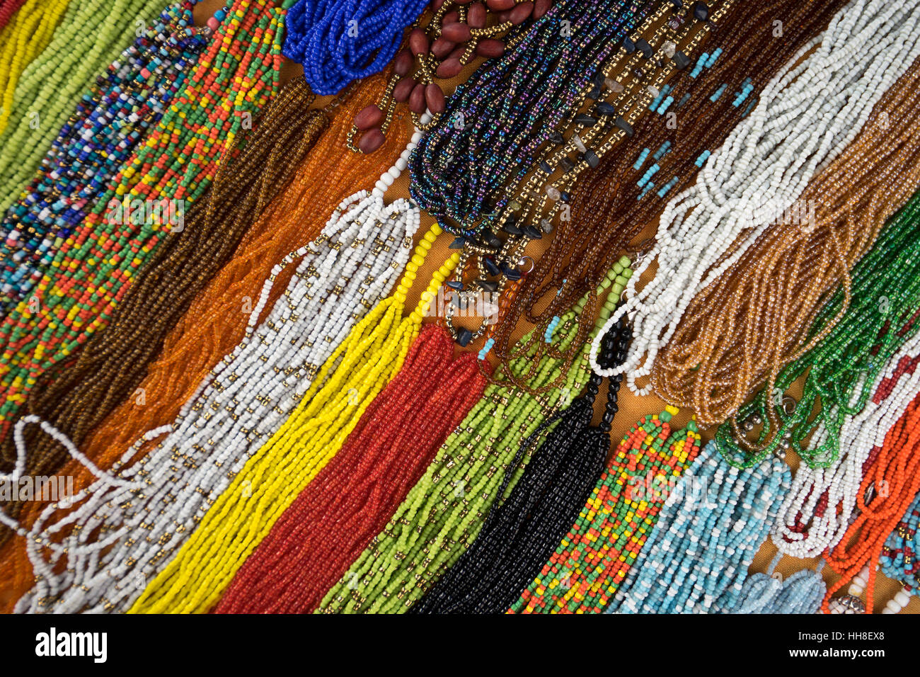 closeup of colorful beaded necklaces Ecuadorian market in Otavalo - Stock Image