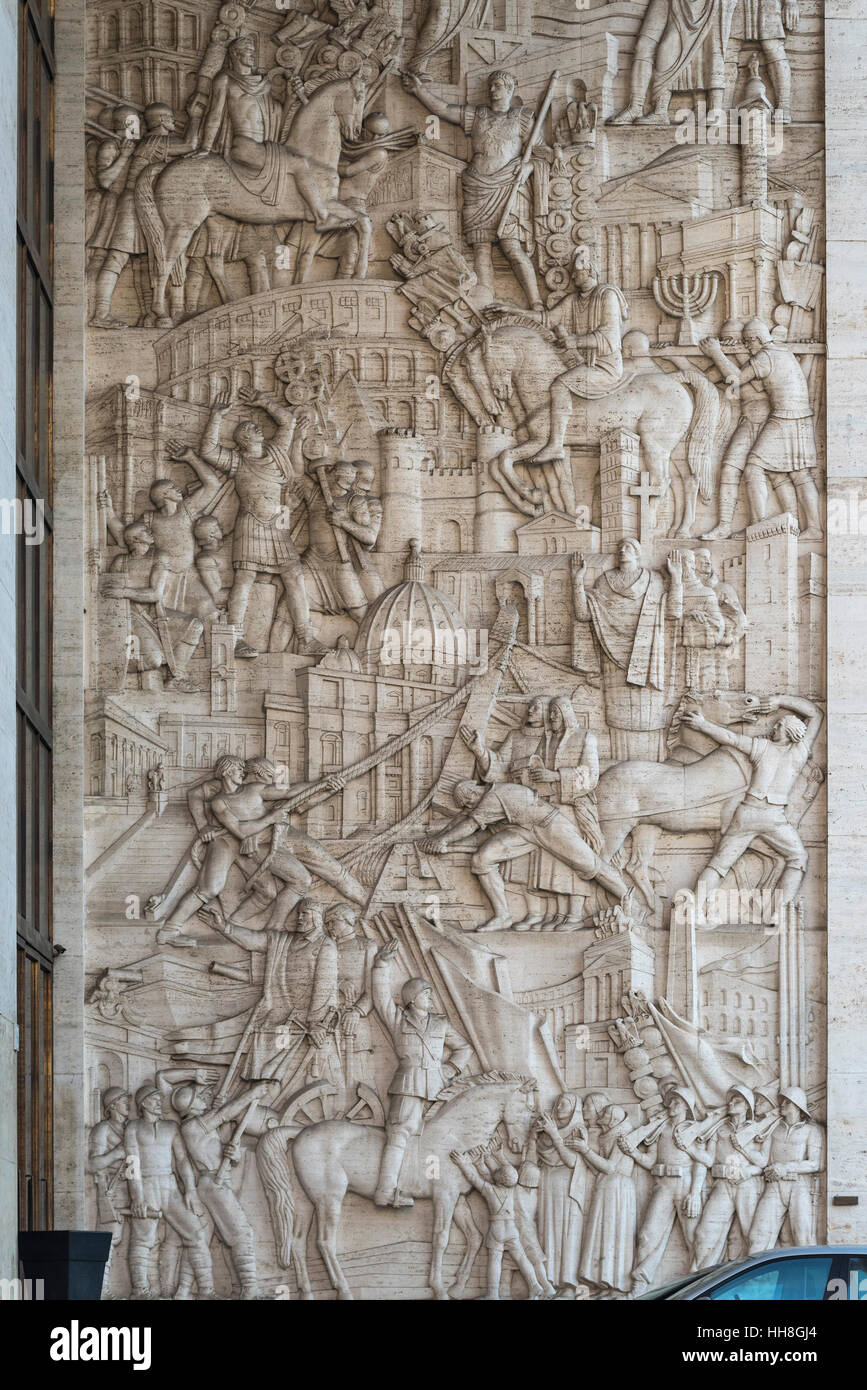 Rome. Italy. EUR. Bas-relief 'A History of Rome Through it's  Public Works', on the Palazzo degli Uffici. - Stock Image
