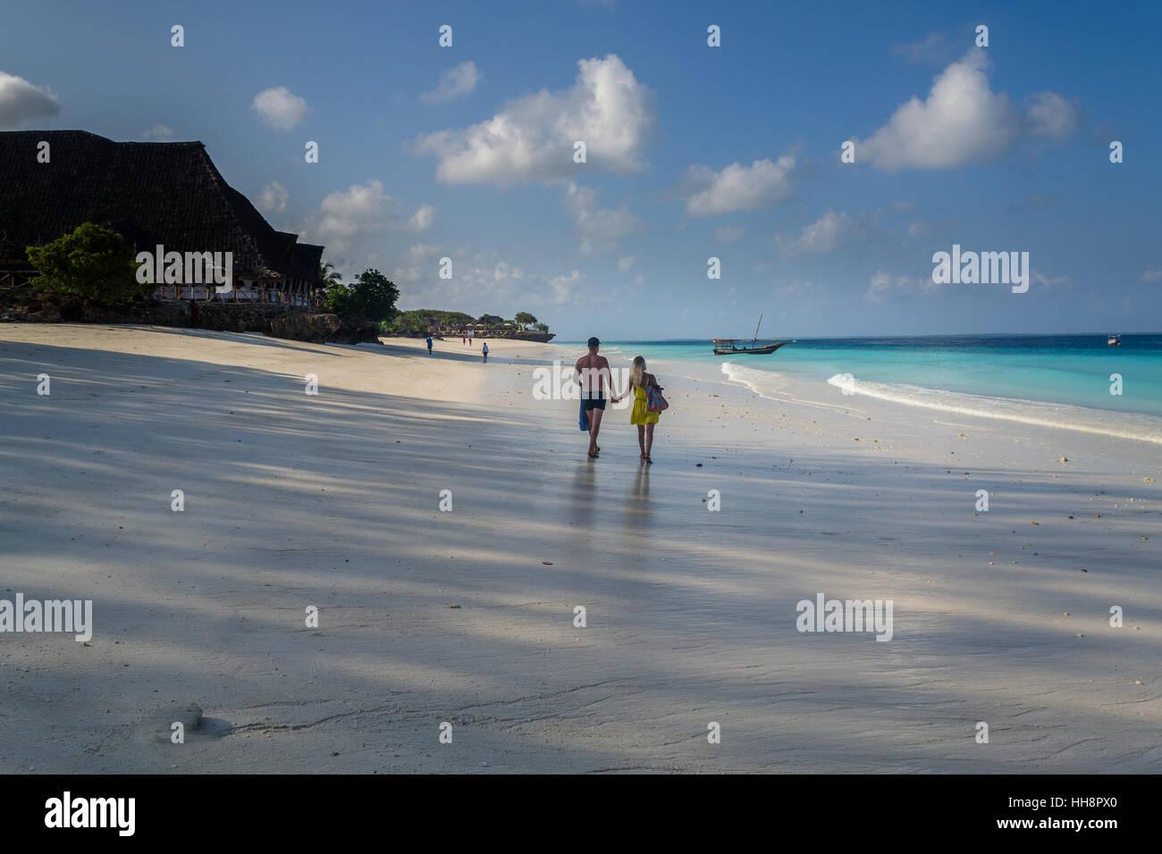 Romantic beach walking early morning at Zanzibar - Stock Image