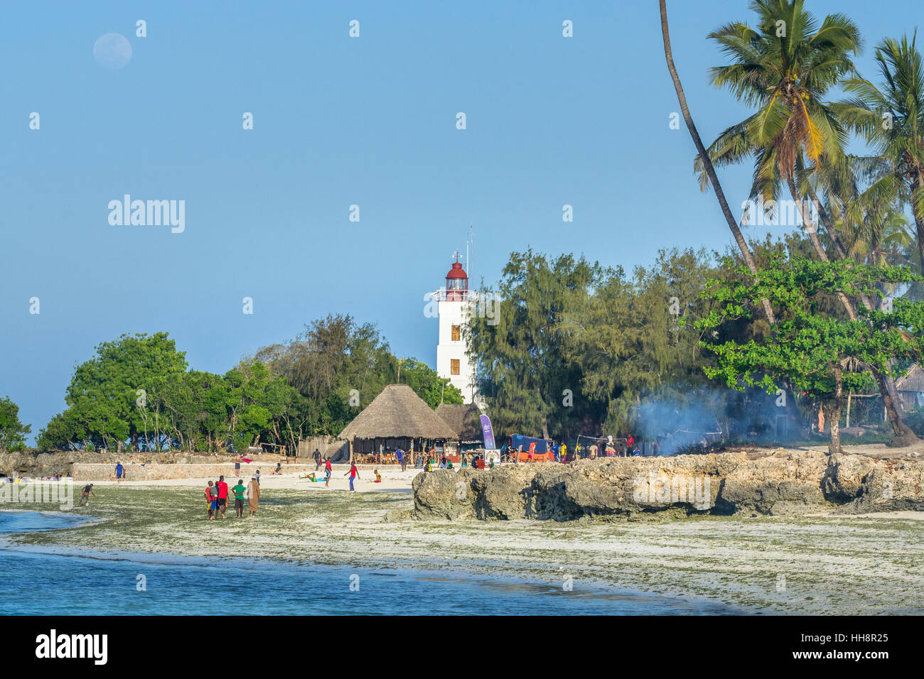 local people next to Nungwi lighthouse - Stock Image