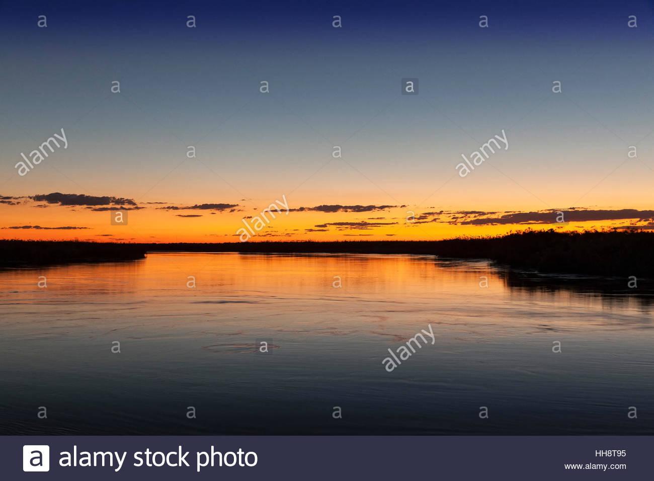 Sunset, Okavango River, Botswana - Stock Image