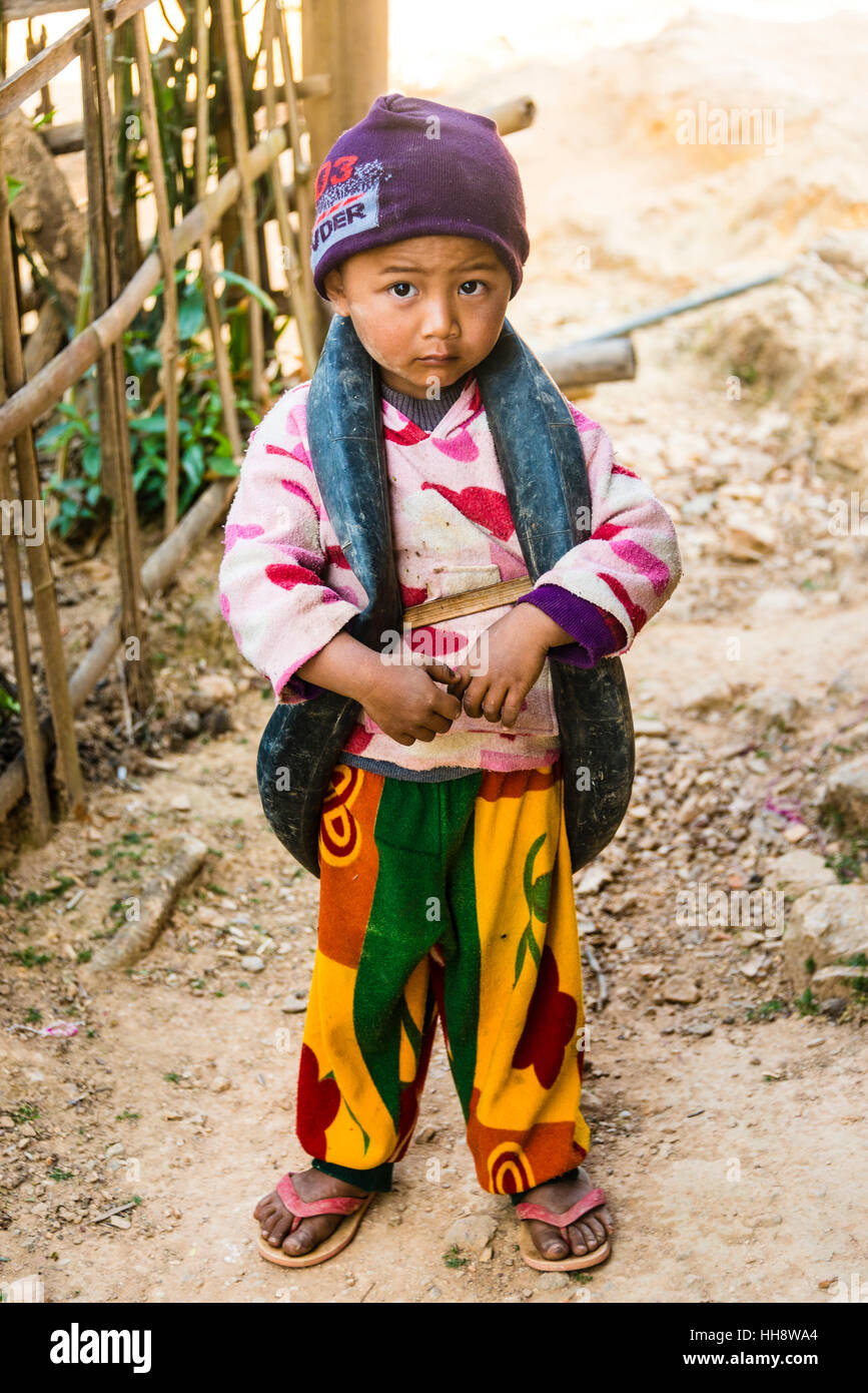Little boy with inner tube of tire as toys around neck, Palaung hilltribe, Palaung Village in Kyaukme, Shan State, - Stock Image