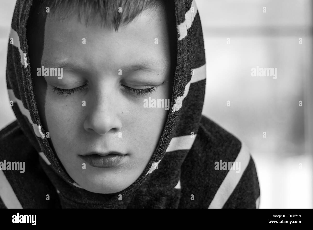 Sad Boy. Teenager with Sad Expression Face Close Up. Depression, Loneliness and Stress Concept. - Stock Image