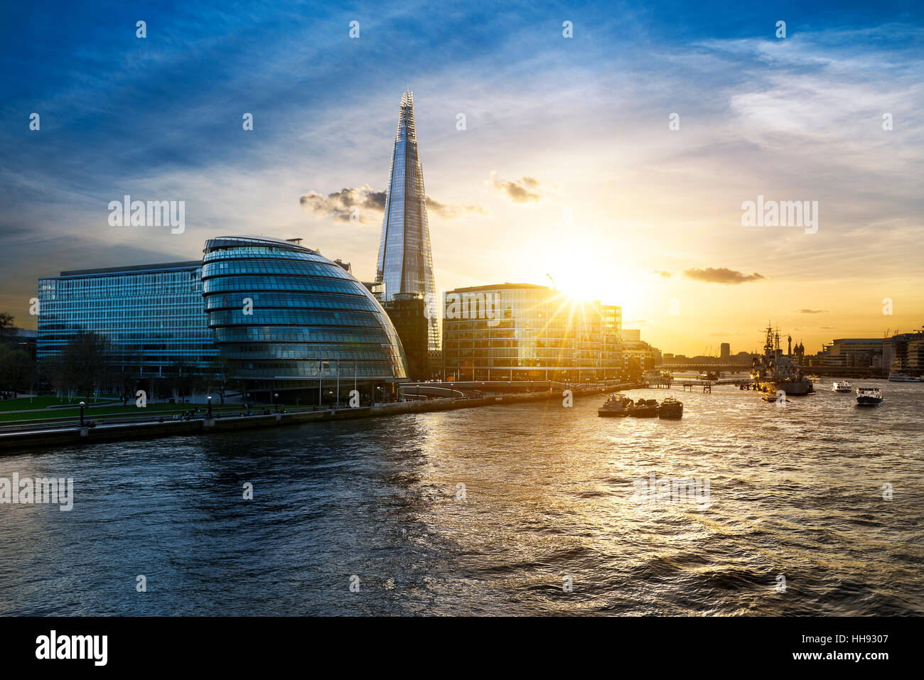 New London city hall at sunset, panoramic view from Thames river - Stock Image