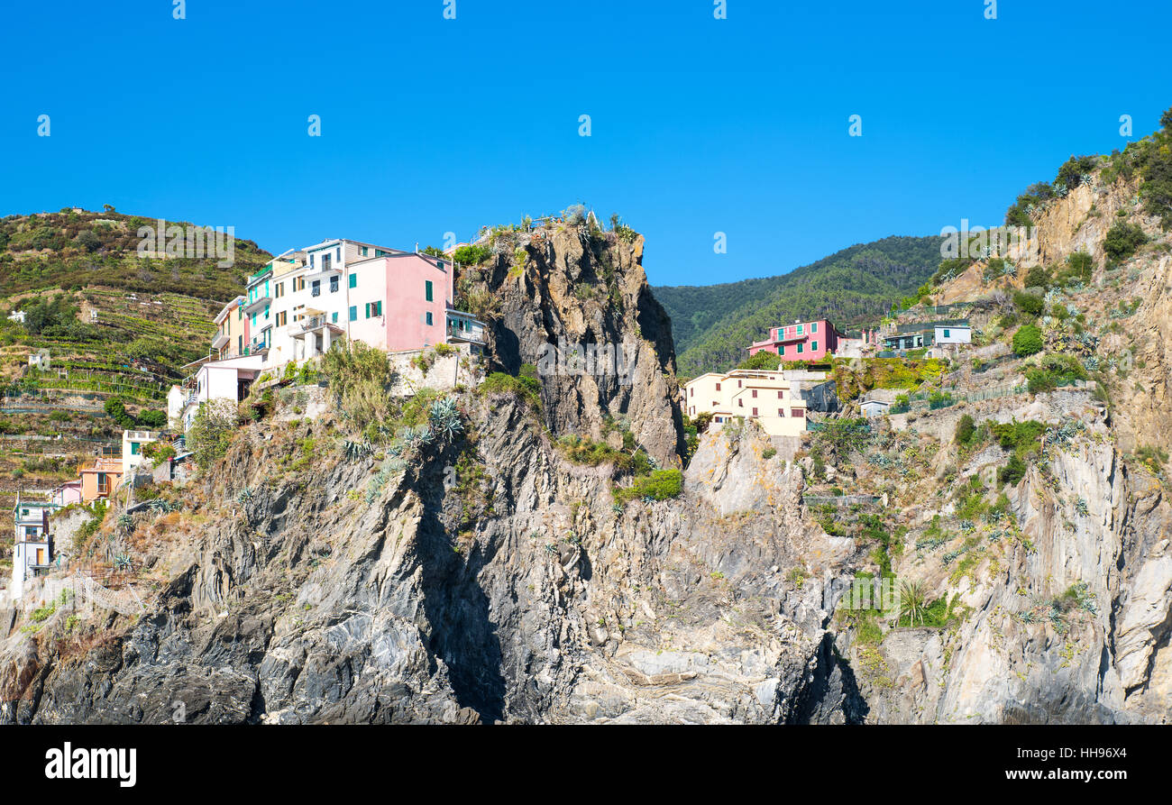 Italy,Manarola,view from the sea of the village climbing on the mountain  rocky ridges. - Stock Image